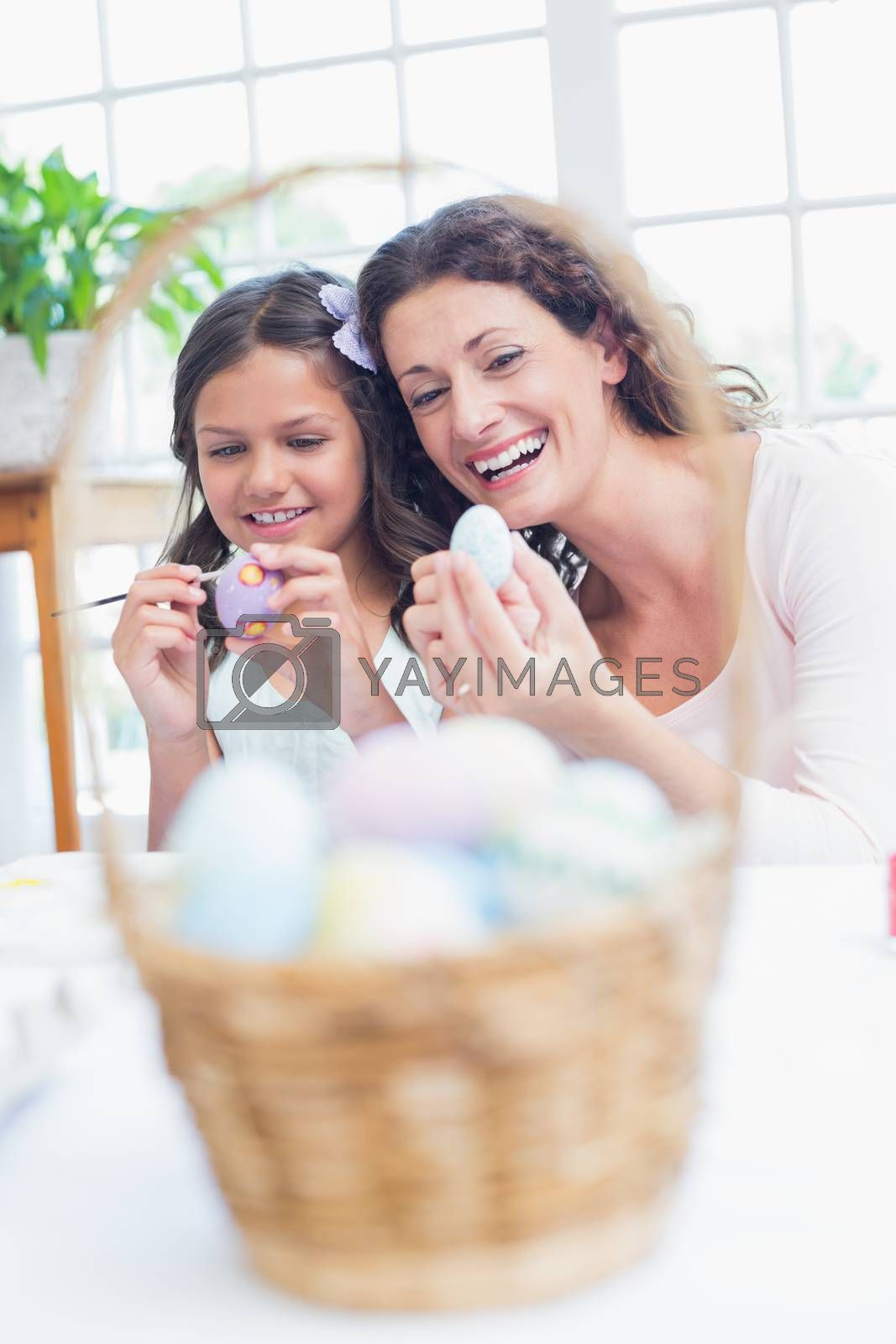 Royalty free image of Happy mother and daughter painting easter eggs  by Wavebreakmedia