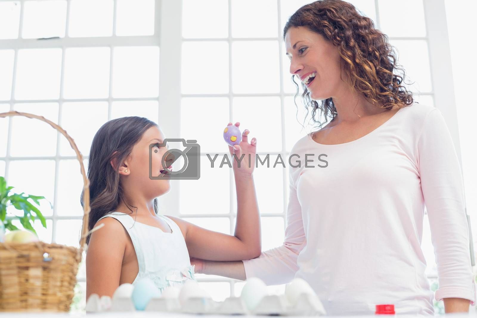 Royalty free image of Happy girl showing easter egg to her mother  by Wavebreakmedia