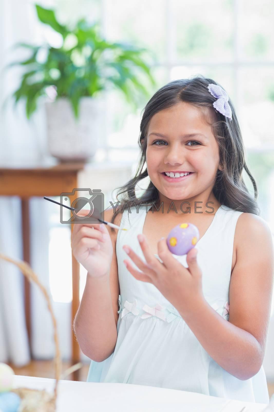Royalty free image of Cute girl painting easter eggs  by Wavebreakmedia