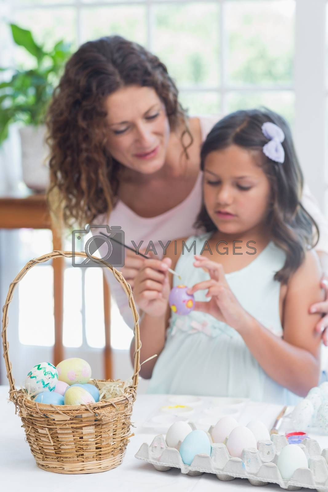 Happy mother and daughter painting easter eggs  by Wavebreakmedia