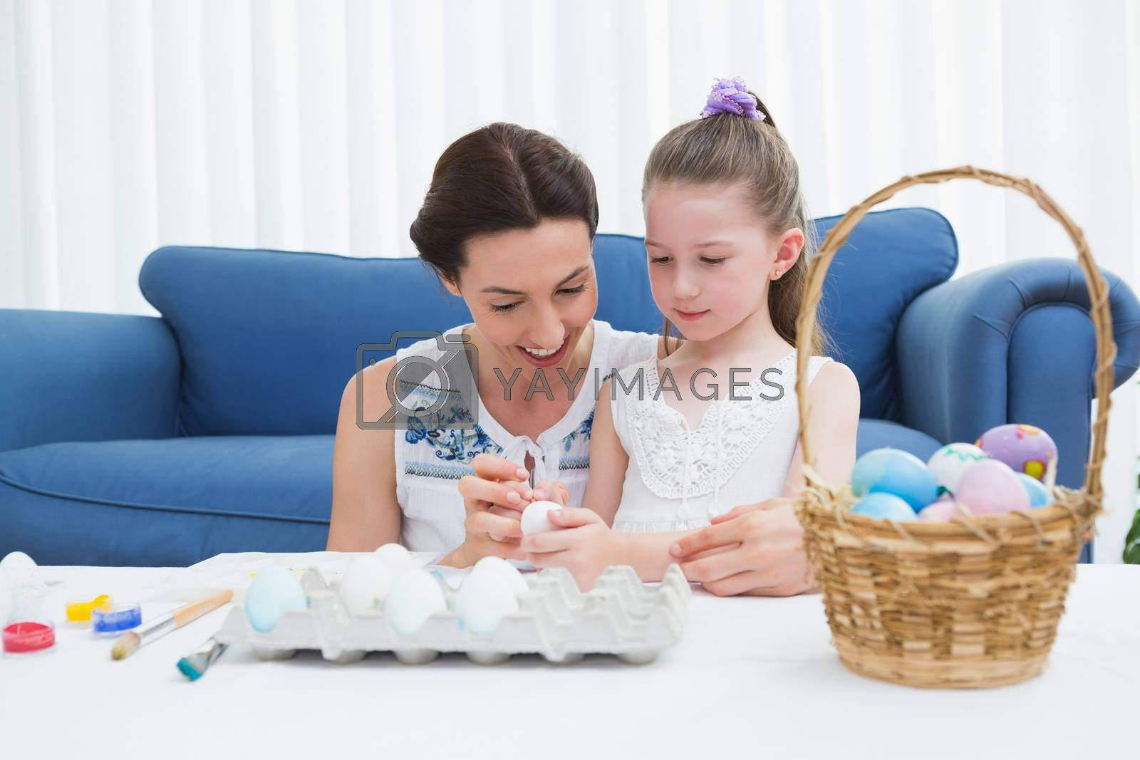 Royalty free image of Mother and daughter painting easter eggs by Wavebreakmedia