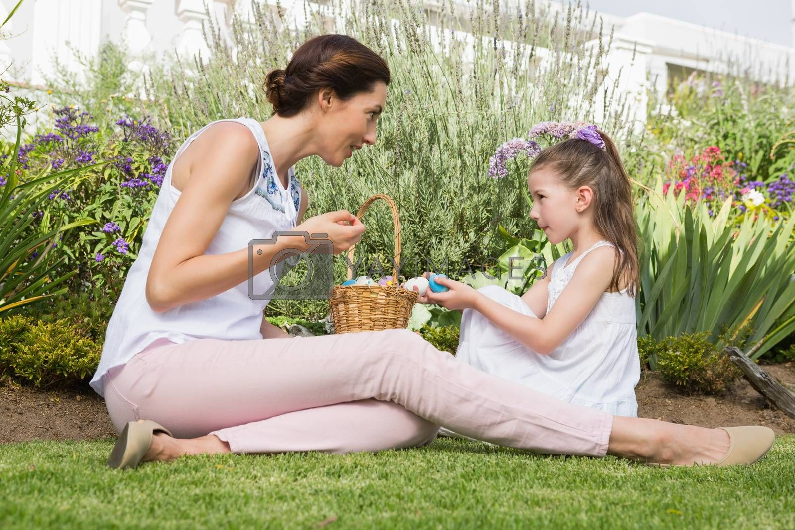 Mother and daughter collecting easter eggs by Wavebreakmedia