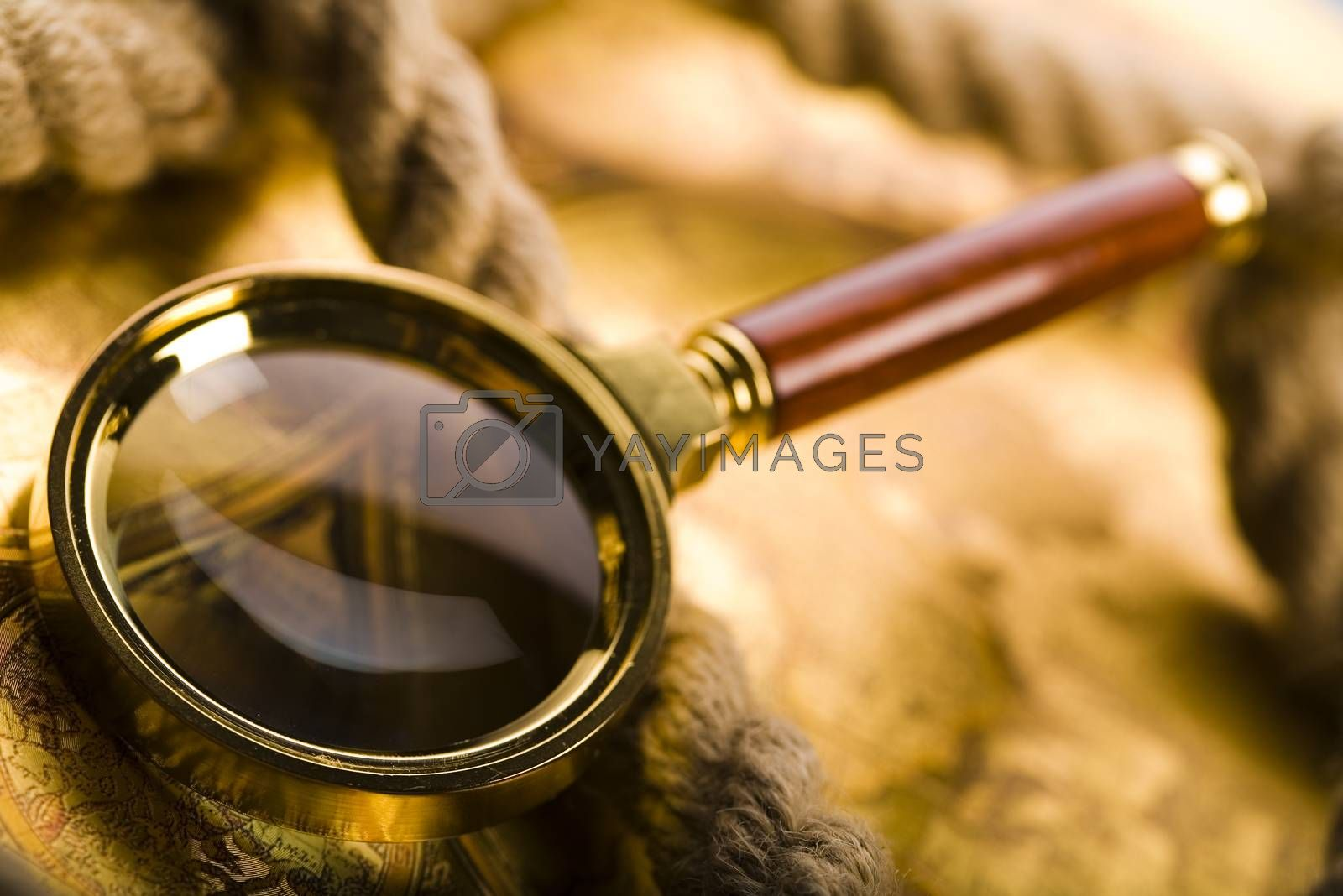 Traveling, magnifying glass and globe, ambient light travel theme by JanPietruszka