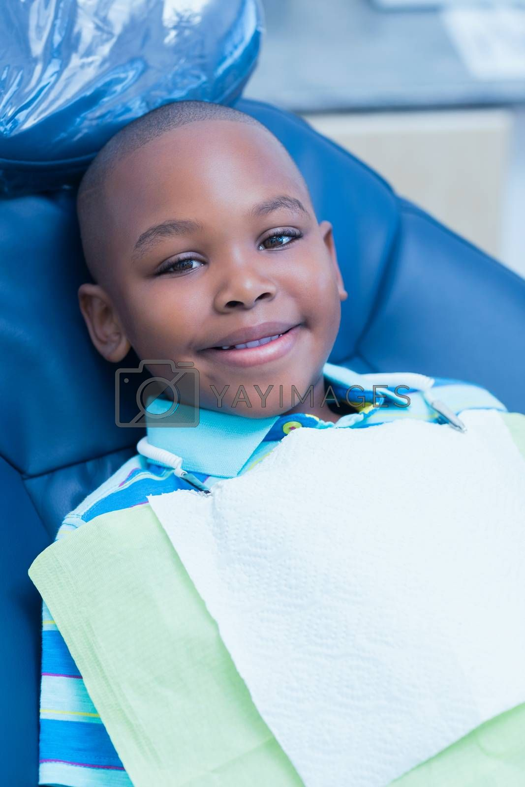 Portrait of smiling boy waiting for a dental exam