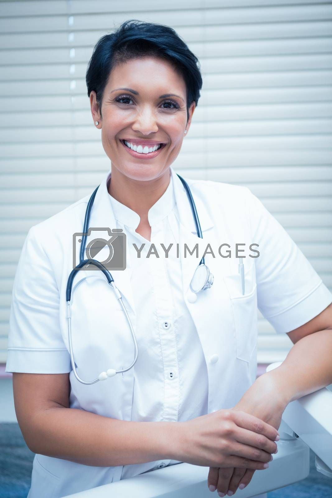 Portrait of confident smiling female dentist