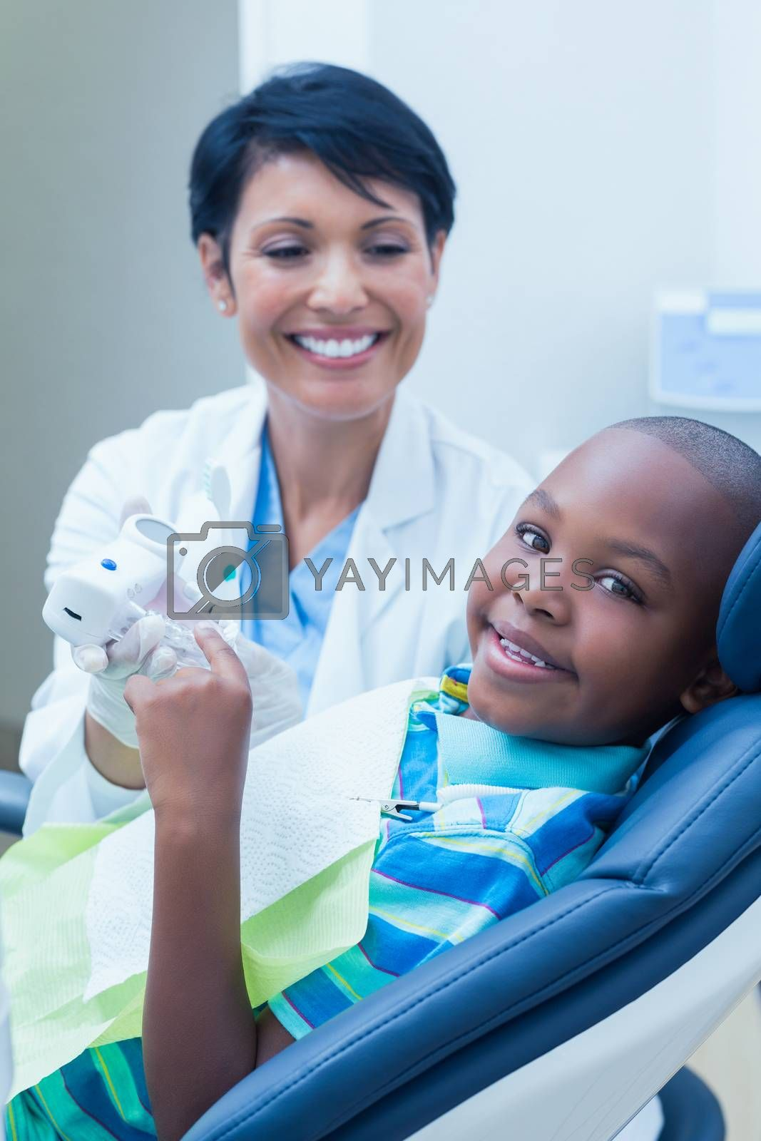 Portrait of smiling boy waiting for a dental exam