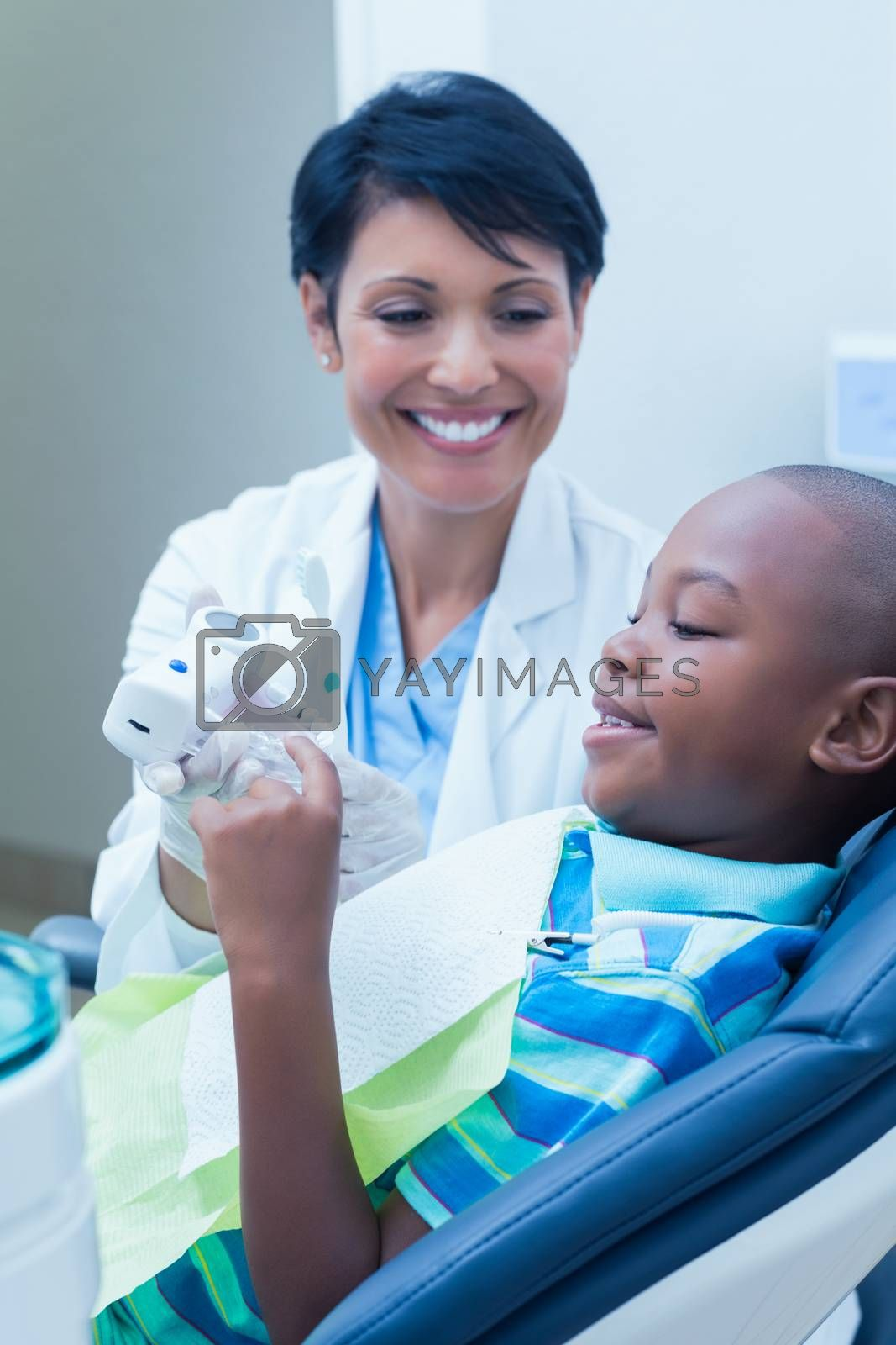 Side view of smiling boy waiting for a dental exam