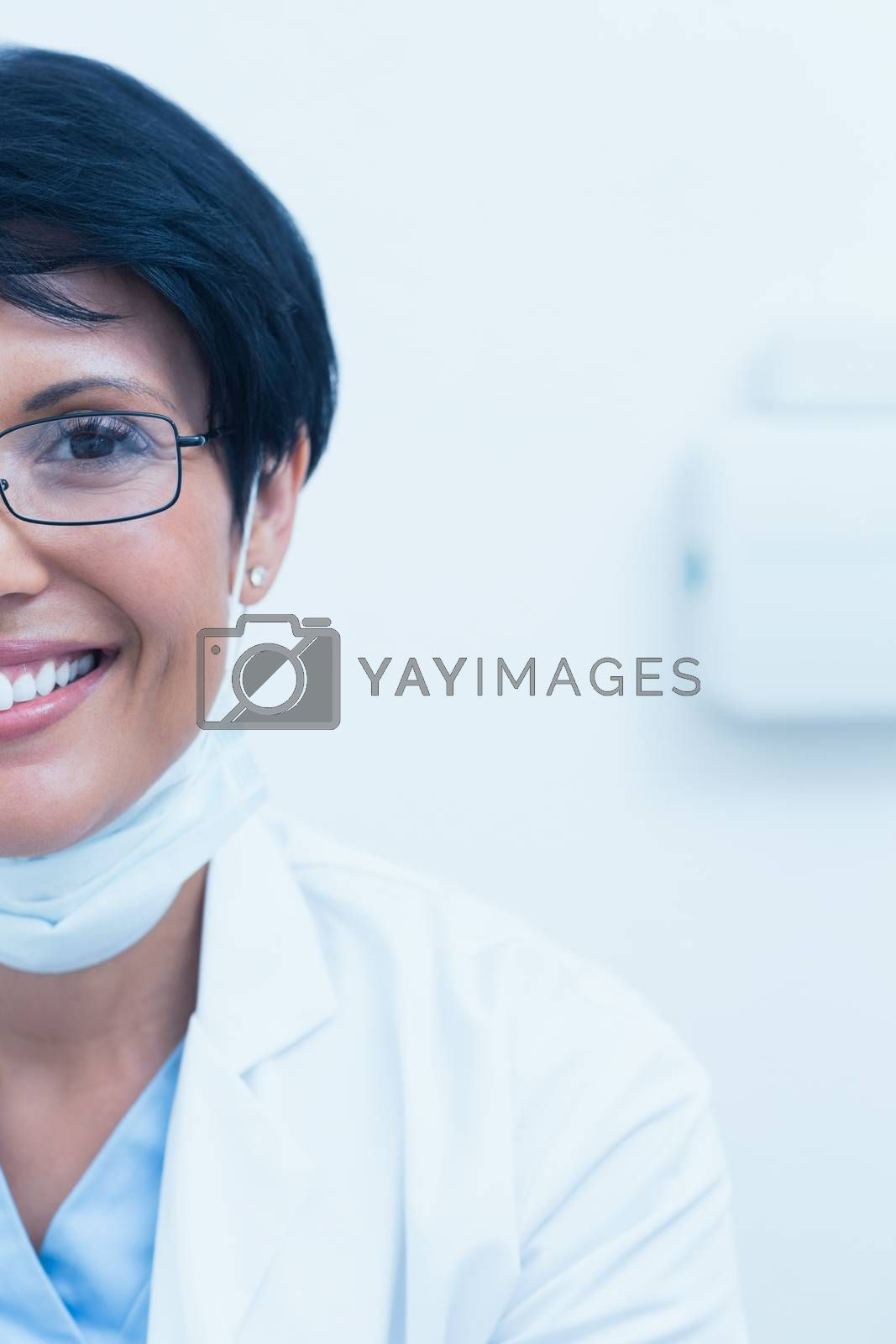Close up portrait of smiling young female dentist