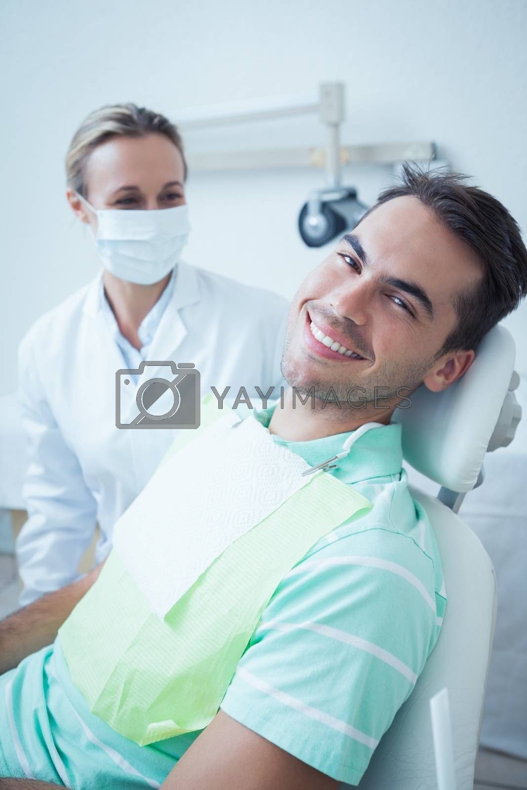 Portrait of smiling young man waiting for a dental exam