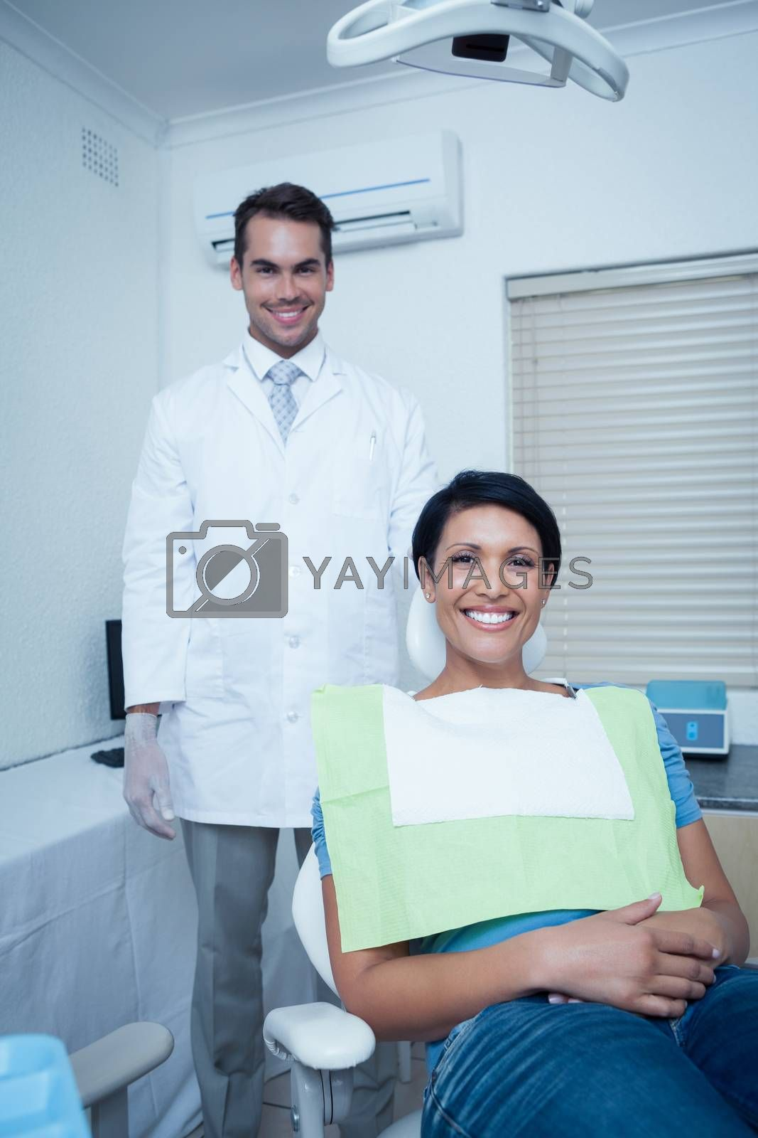 Portrait of smiling young woman waiting for a dental exam