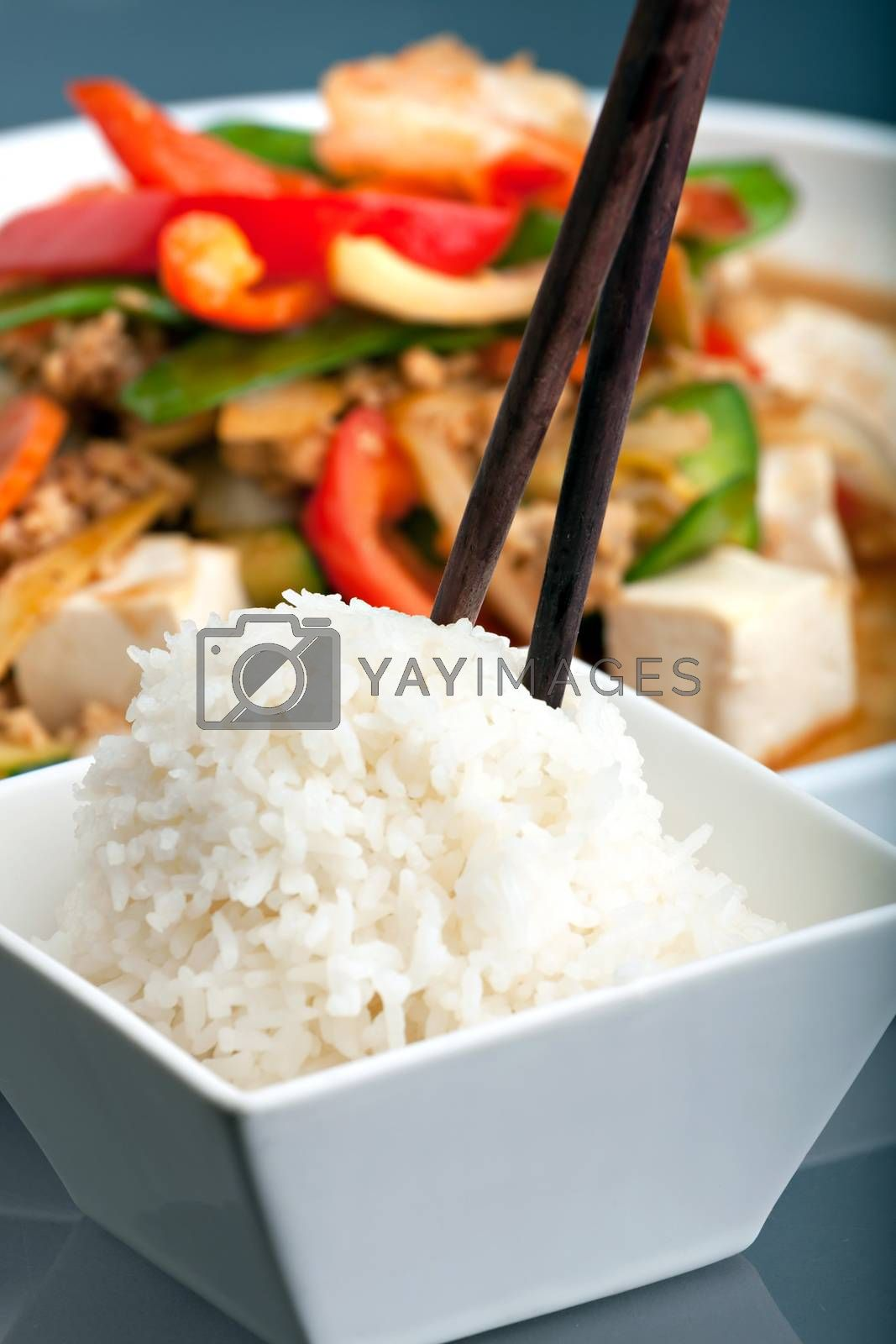 Fresh Thai food stir fry with tofu and white jasmine rice.