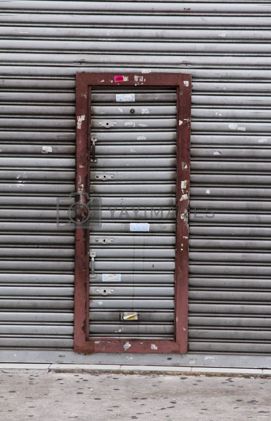 Grey iron door isolated with red framework