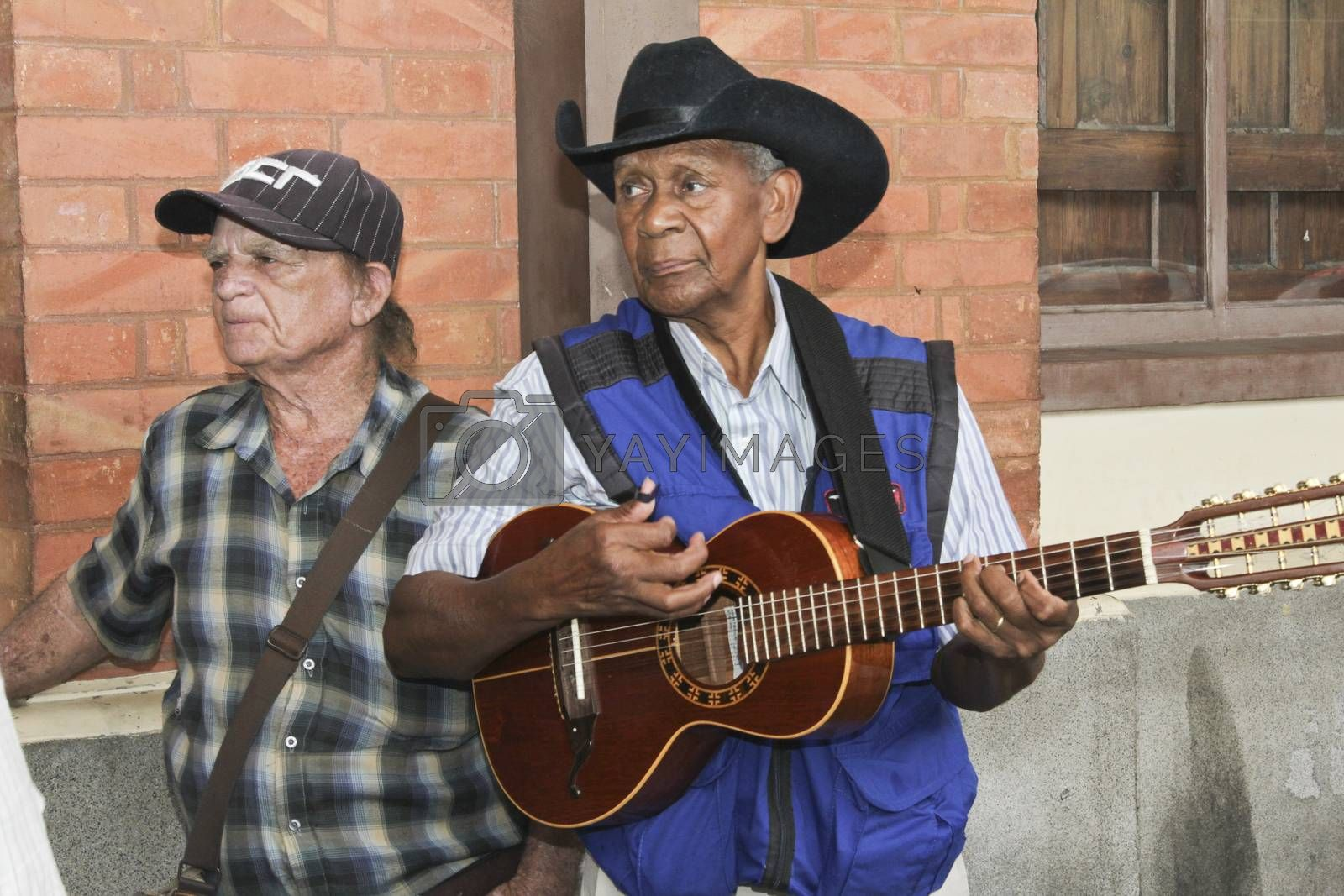 SAO PAULO, BRAZIL - MARCH 8, 2015: An unidentified group of men playing guitar and singing country musics in front of Luz Station on Sao Paulo Brazil.