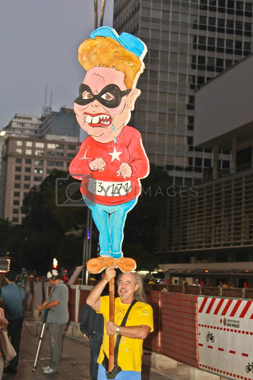 SAO PAULO, BRAZIL - APRIL 12, 2015: An unidentified man at protest against federal government corruption in Sao Paulo Brazil. Protesters call for the impeachment of President Dilma Rousseff.