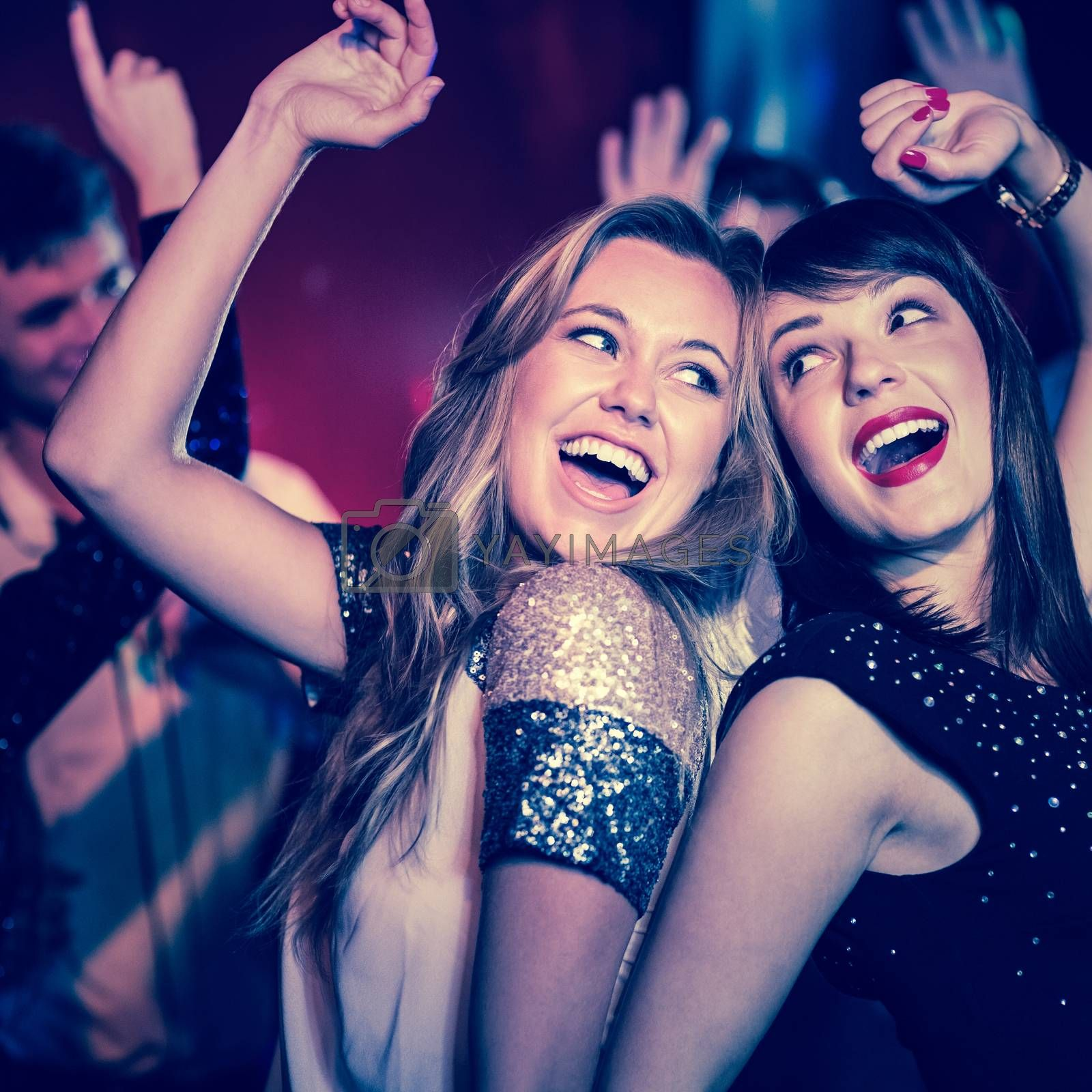 Happy friends having fun together at the nightclub