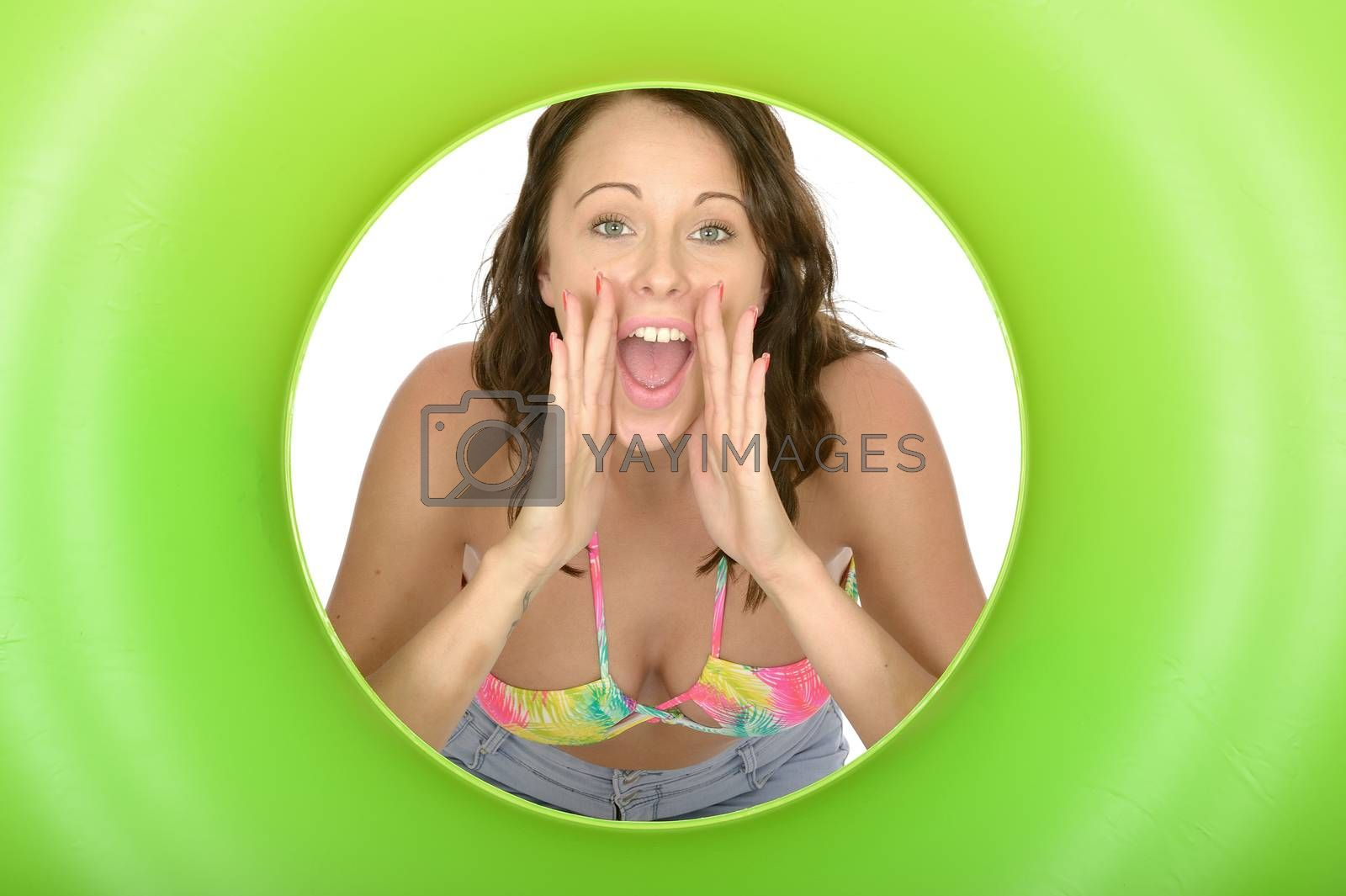 Attractive Young Woman Looking Through a Green Rubber Ring Shouting