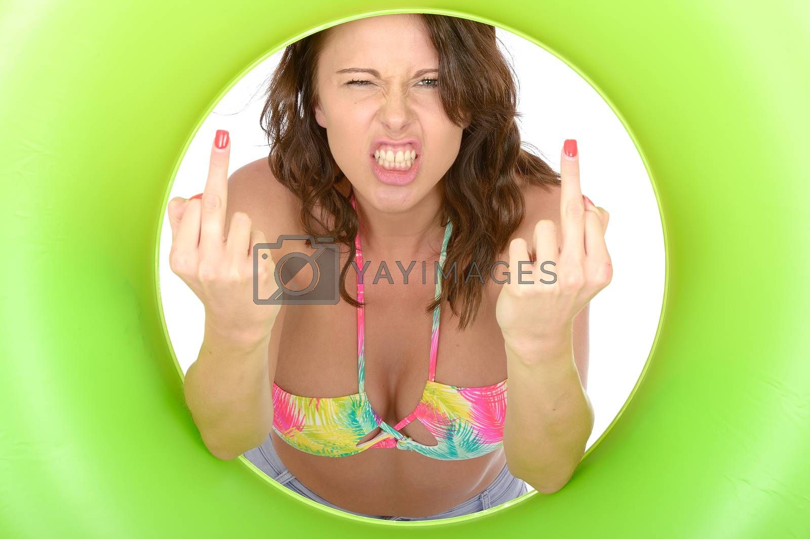 Attractive Young Woman Looking Through a Green Rubber Ring Giving Middle Finger on Both Hands