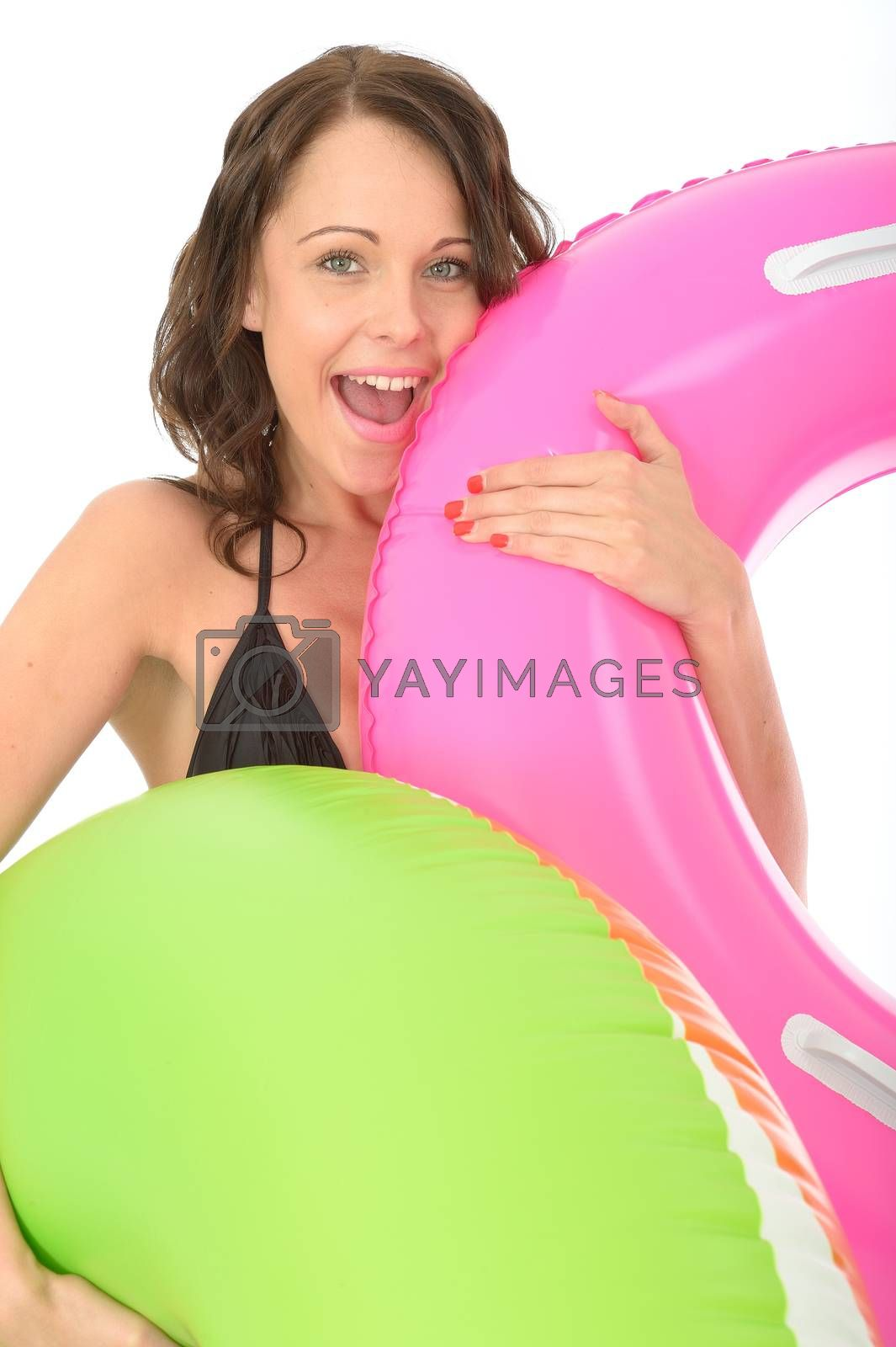 Happy Young woman On Holiday Holding Inflated Rubber Rings Laughing and Smiling