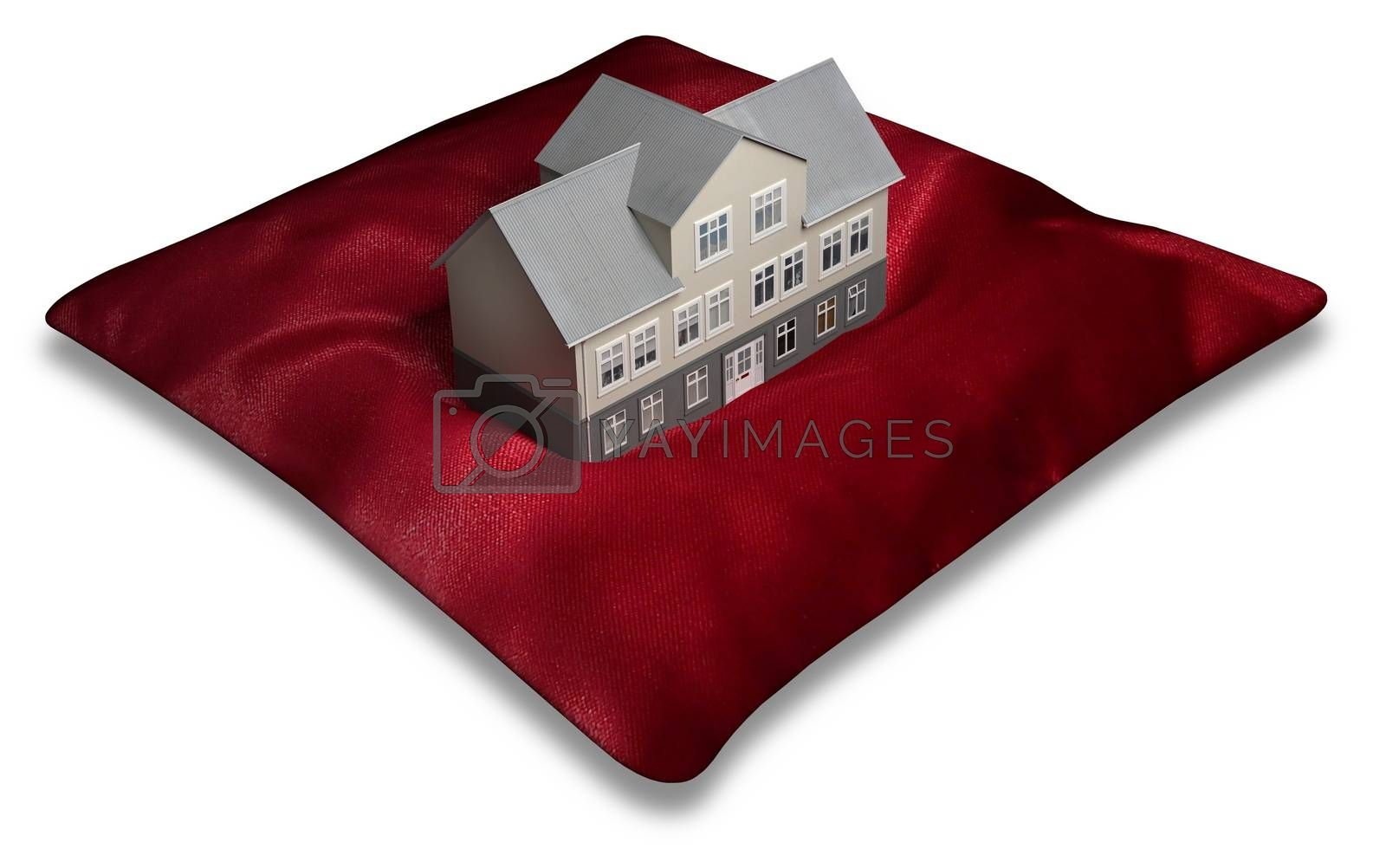 Illustration of a building on top of a red pillow