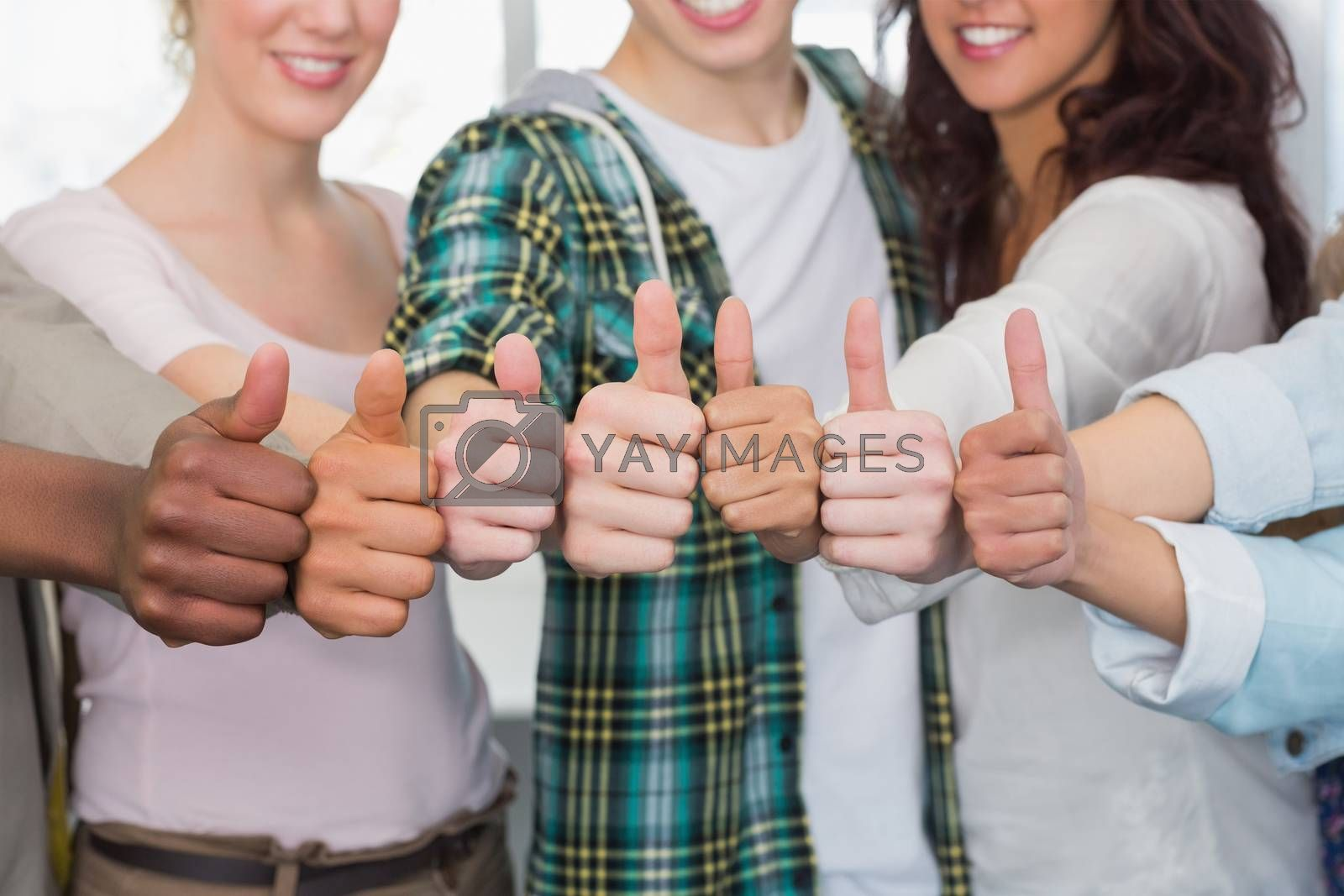 Fashion students showing thumbs up at the college