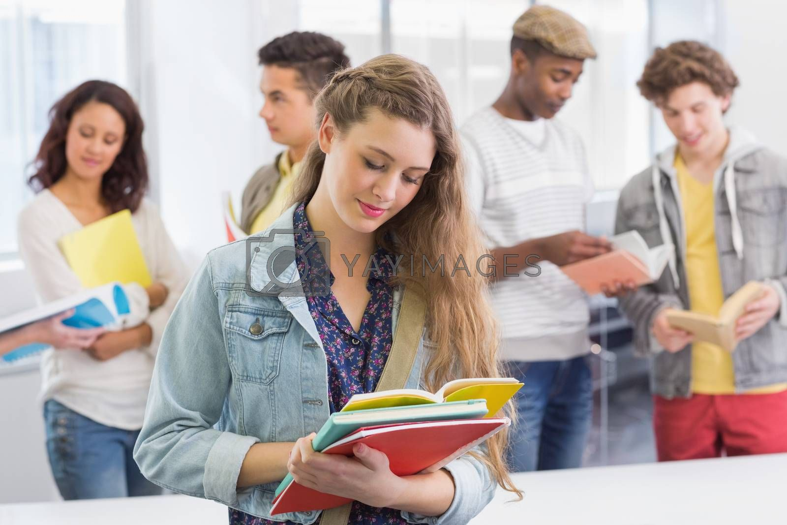 Fashion student reading her notes at the college