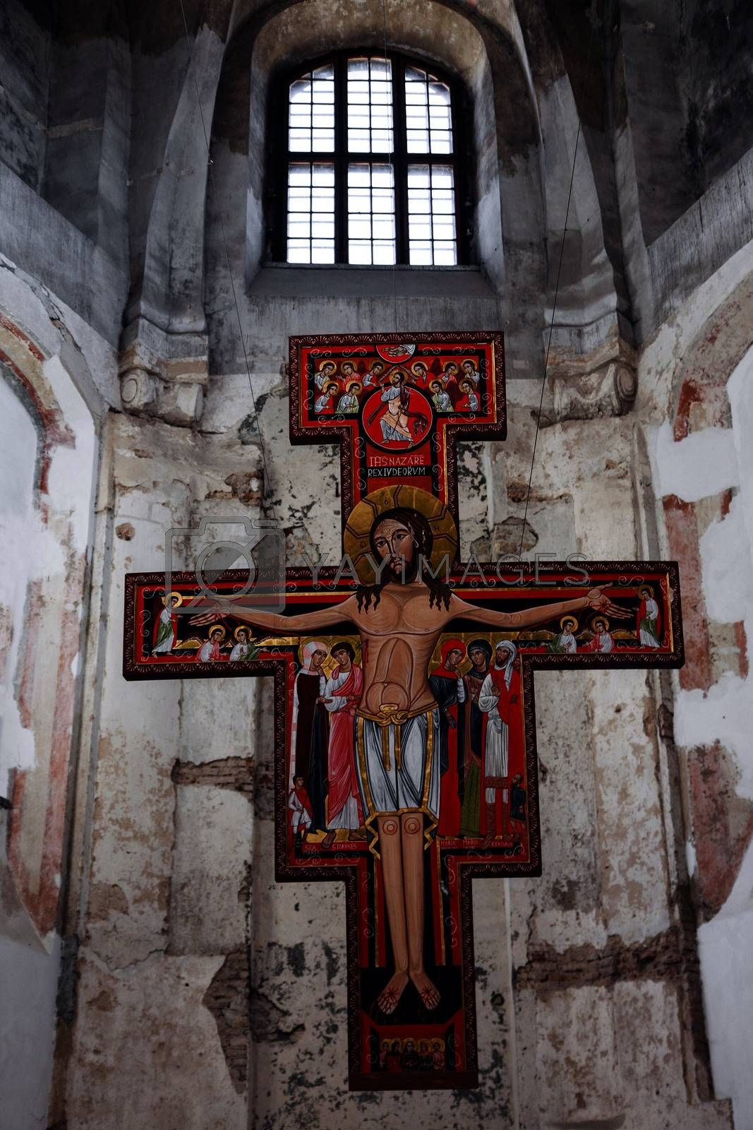 Altar with Jesus in the interior of weathered orthodox Christian church in Vilnius, Lithuania