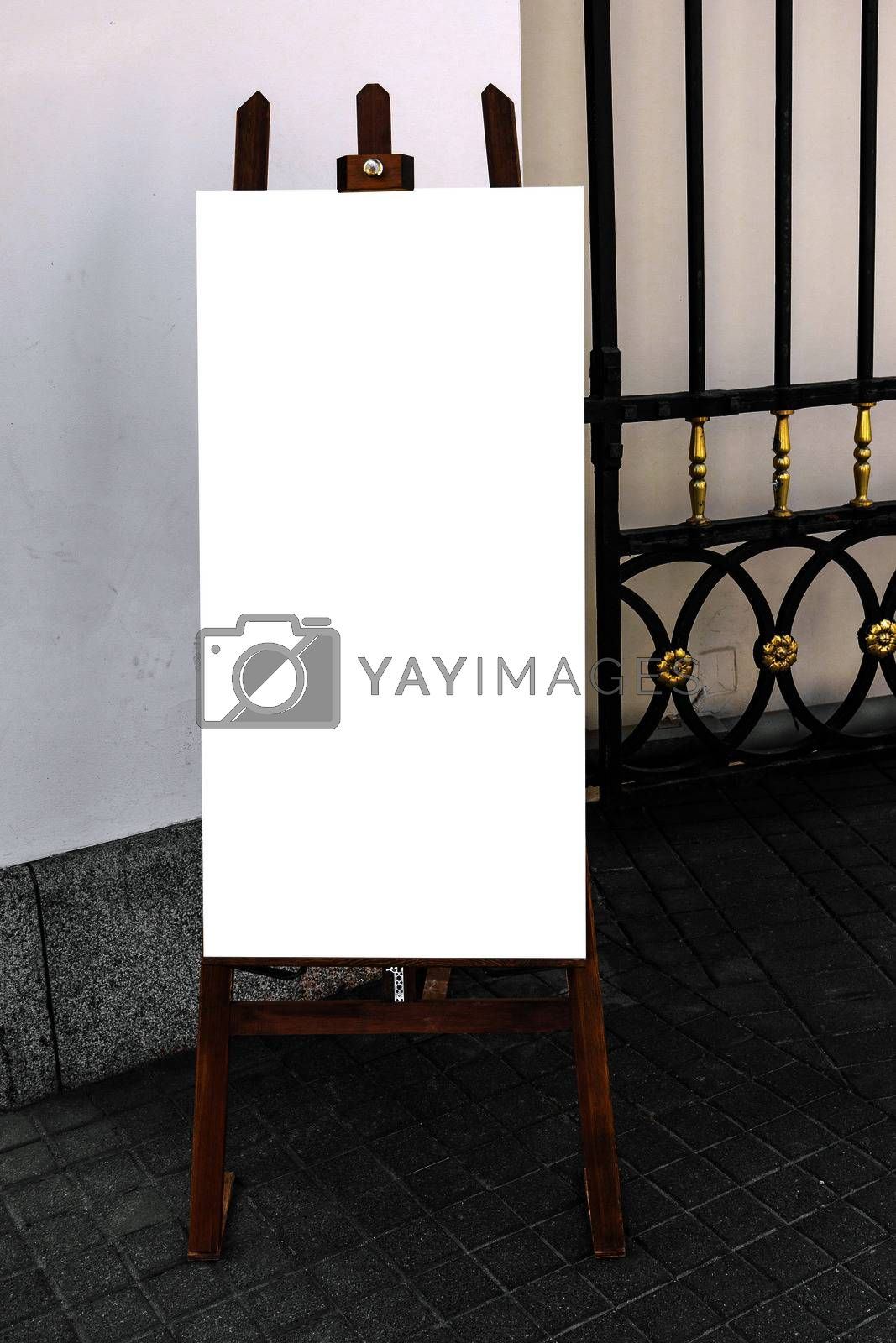 Picture of blank wooden placard, standing on the street, ready to put any text