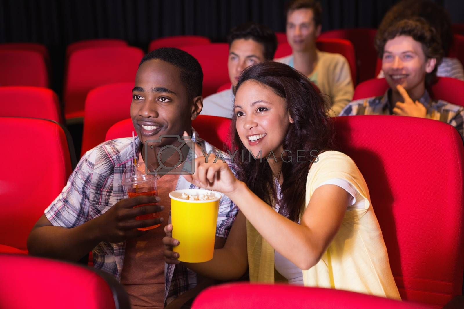 Young people watching a film at the cinema