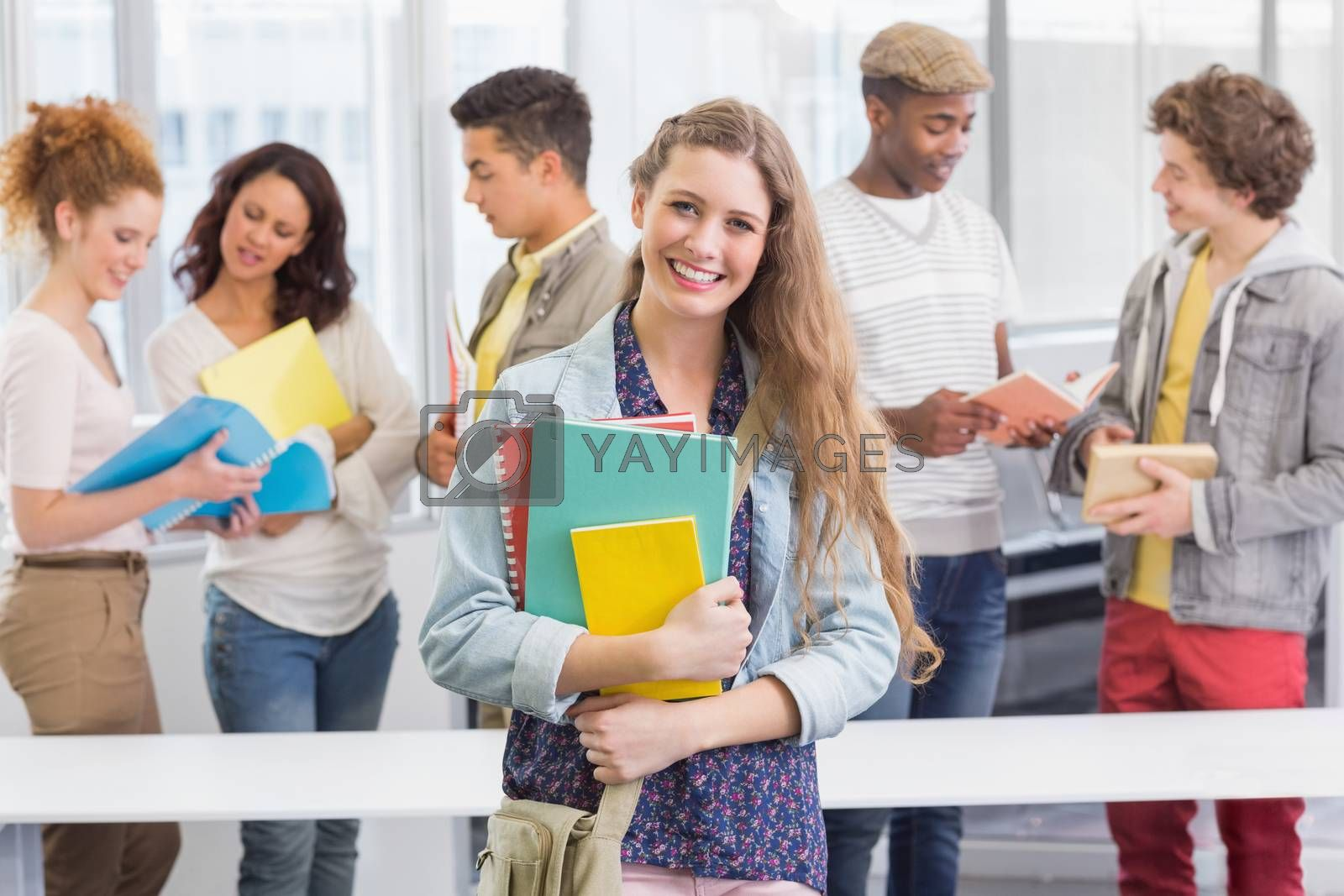 Fashion student smiling at camera at the college