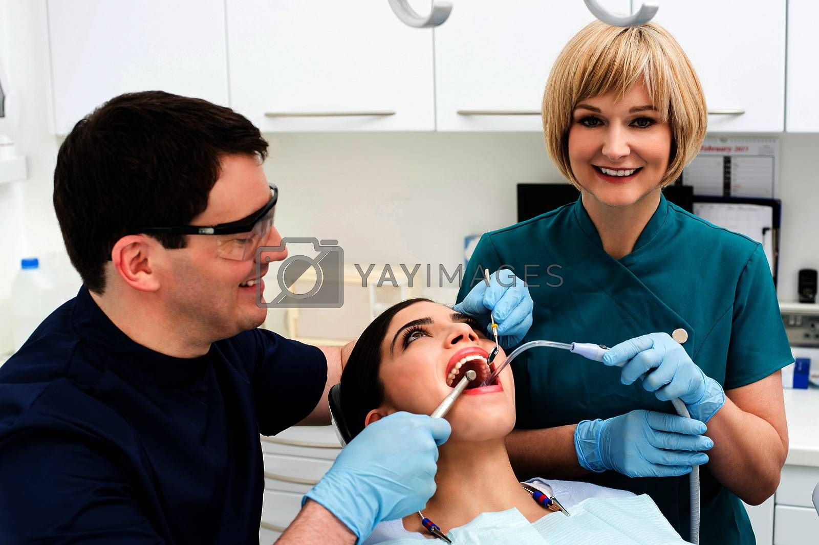 Young woman patient undergoing a dental check