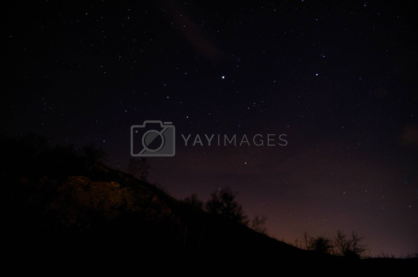 beautiful starry sky at night with mountain