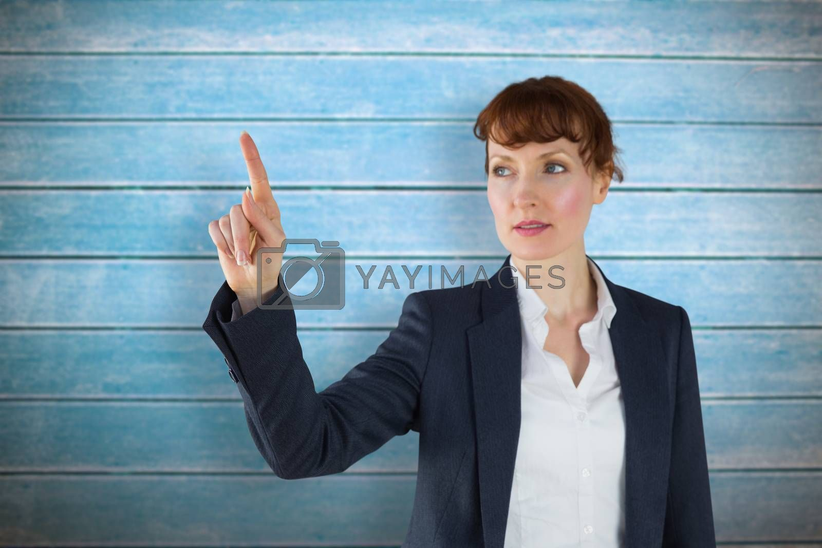 Businesswoman pointing against wooden planks