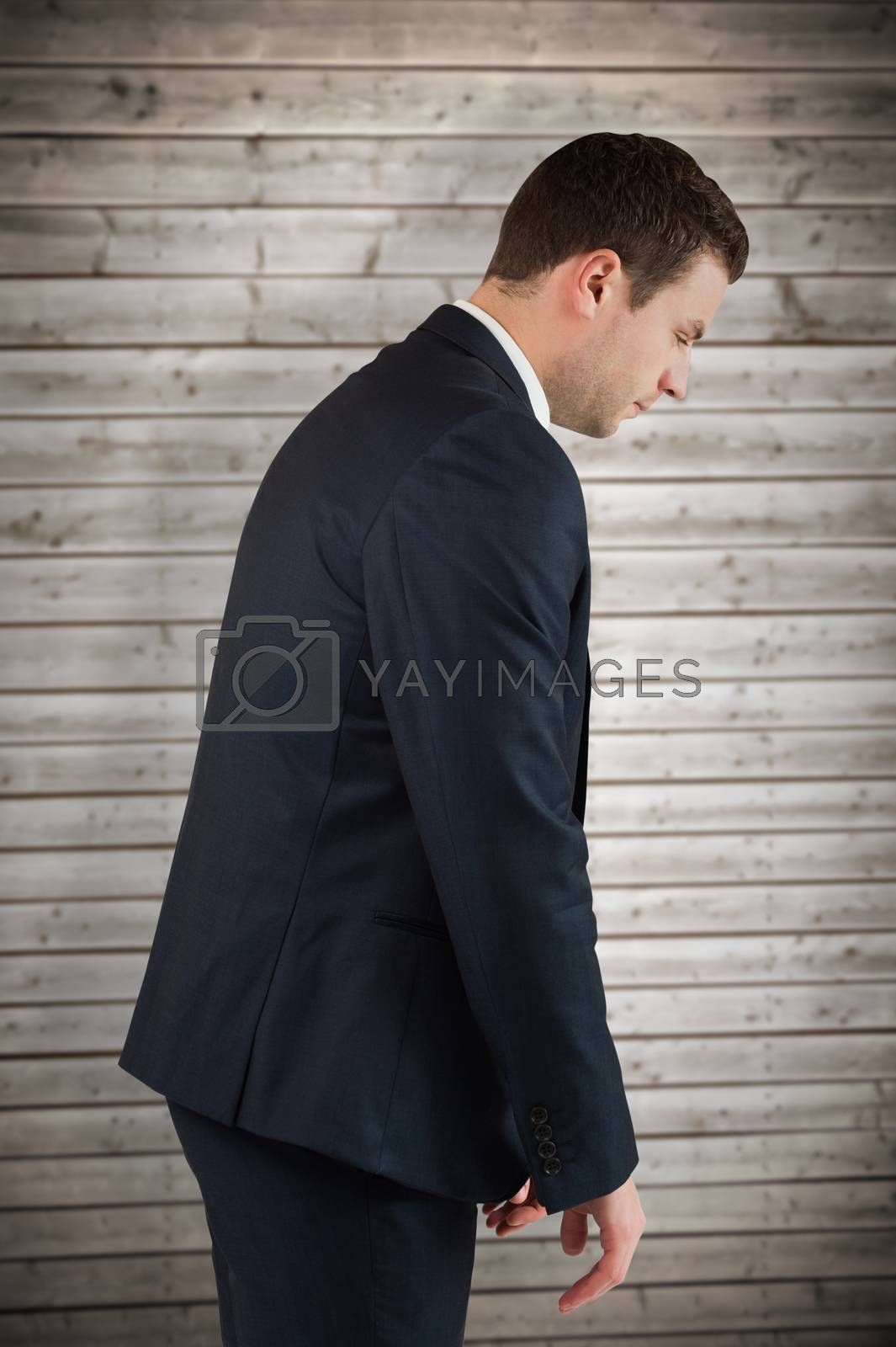 Businessman bowing against wooden planks background