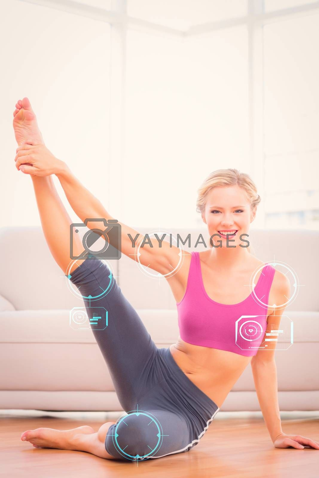 Athletic blonde sitting on floor stretching leg up smiling at camera against fitness interface