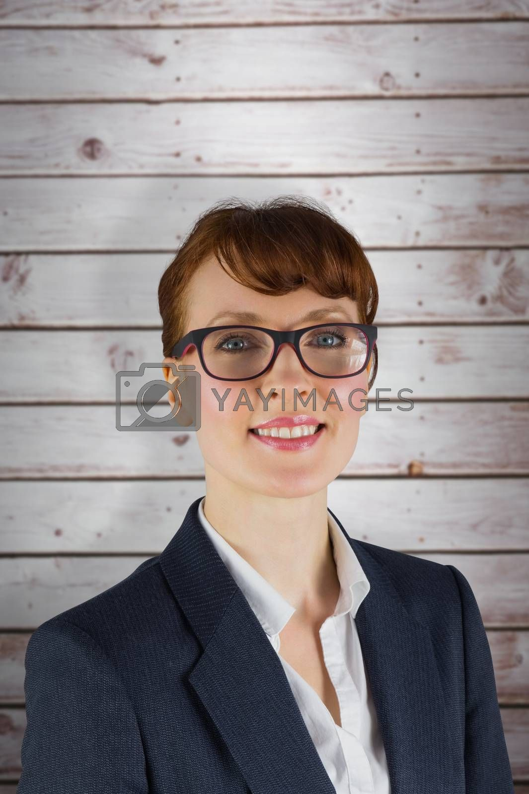 Happy businesswoman against wooden planks