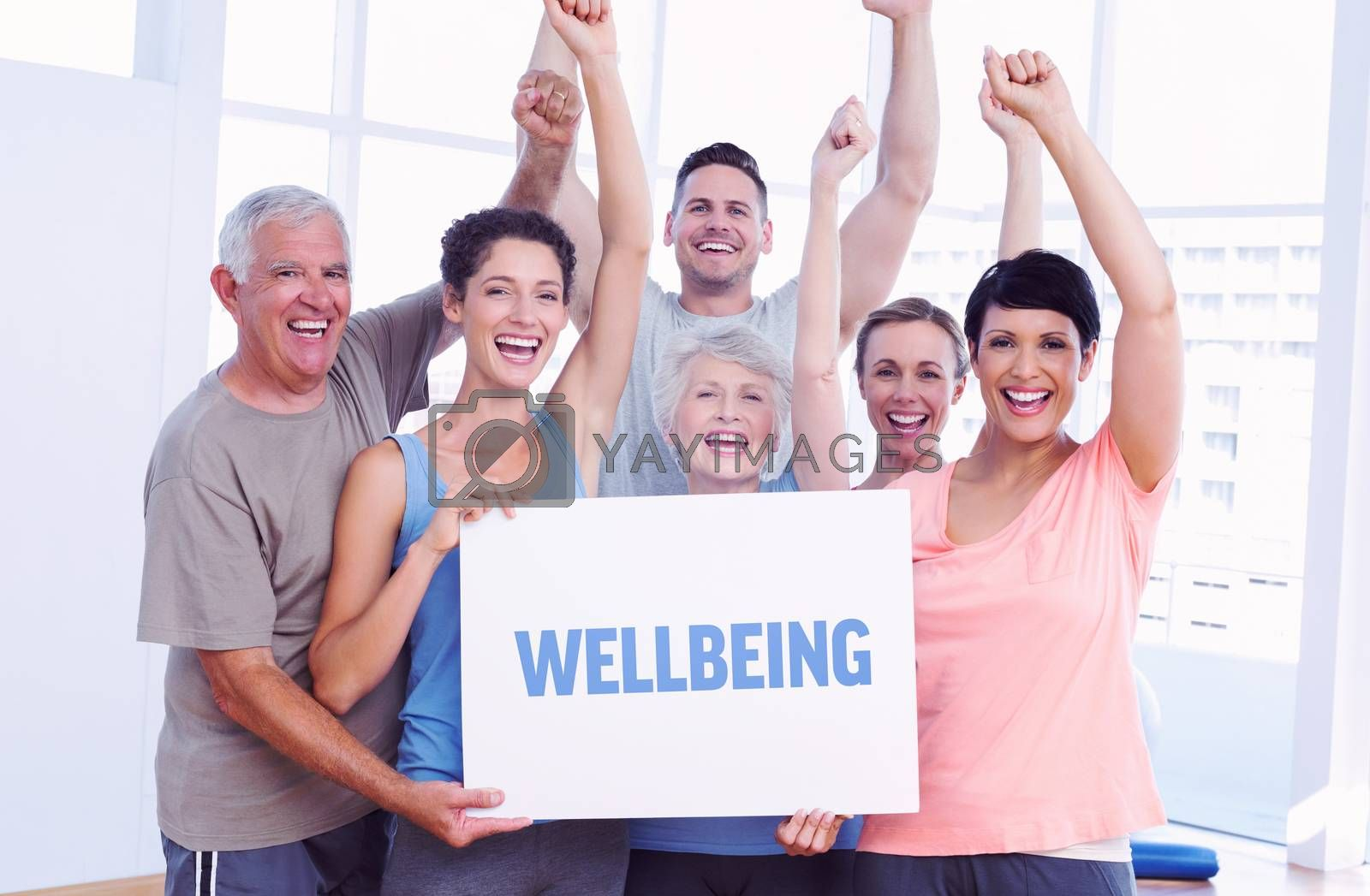 The word wellbeing against portrait of happy fit people holding blank board
