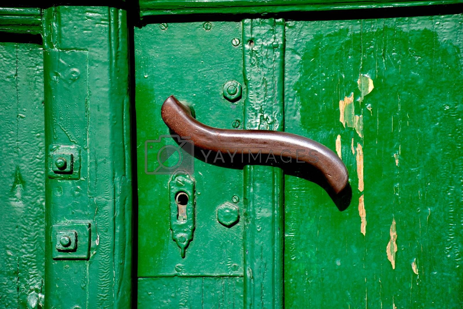 Doorhandle on a green door
