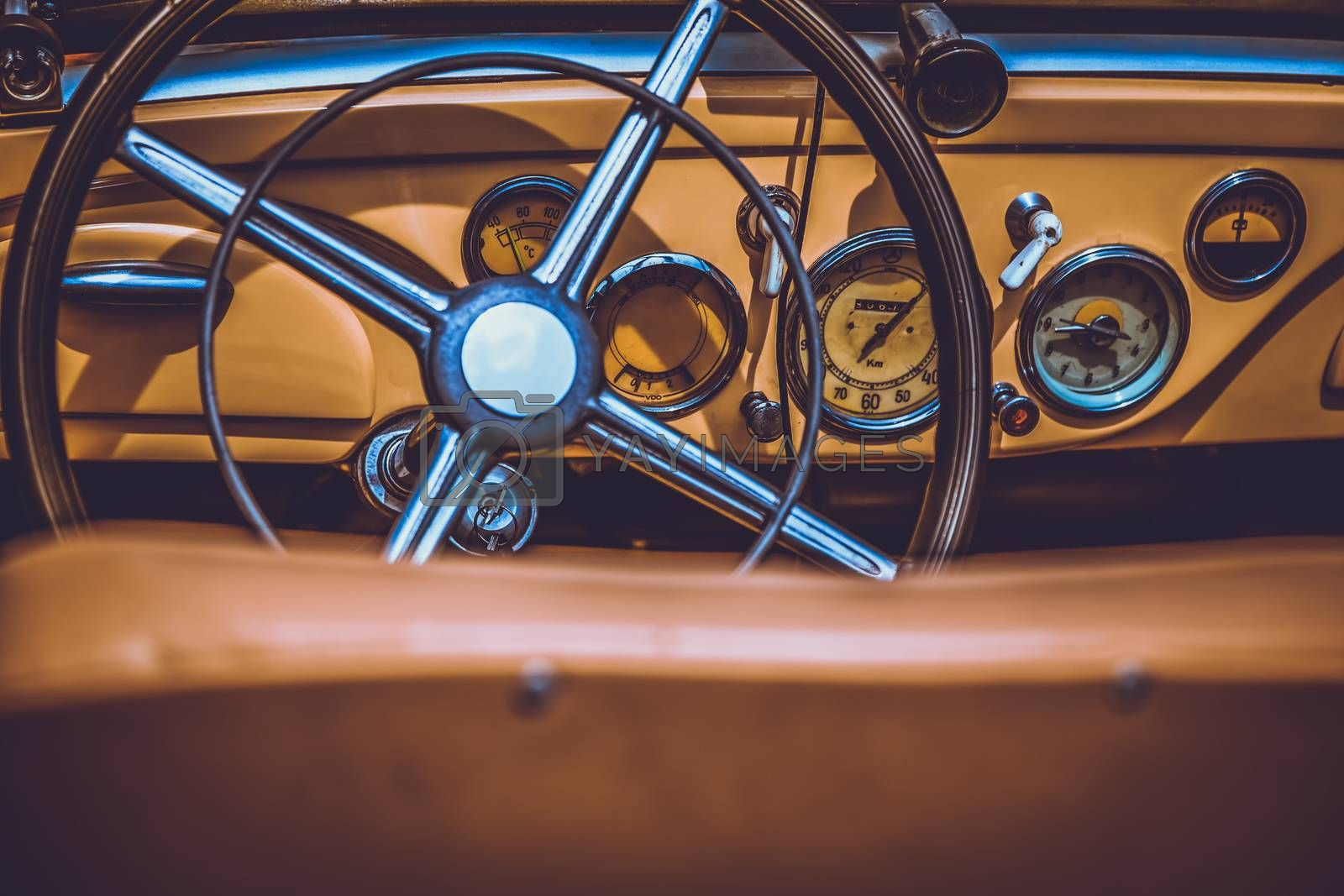 Steering wheel and dashboard in interior of old retro automobile. Processed by vintage or retro effect filter