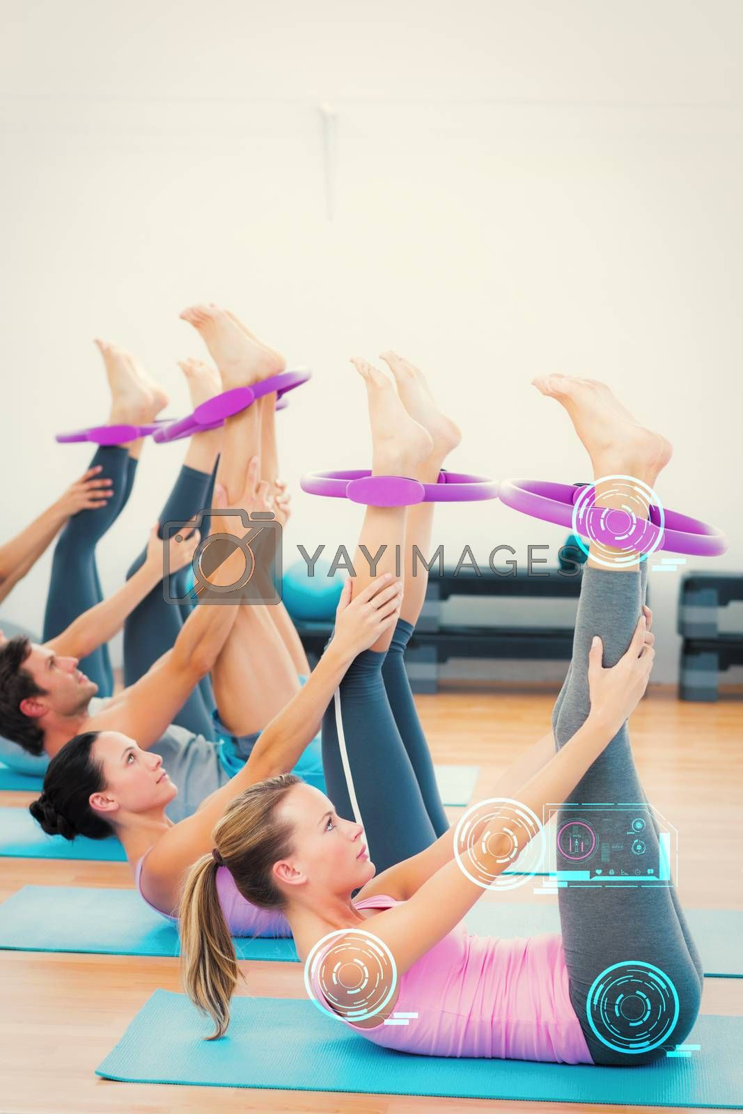 Sporty people with exercising rings in fitness studio against fitness interface