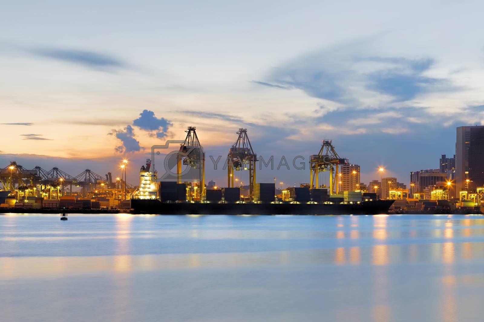 View of Singapore container port at sunset