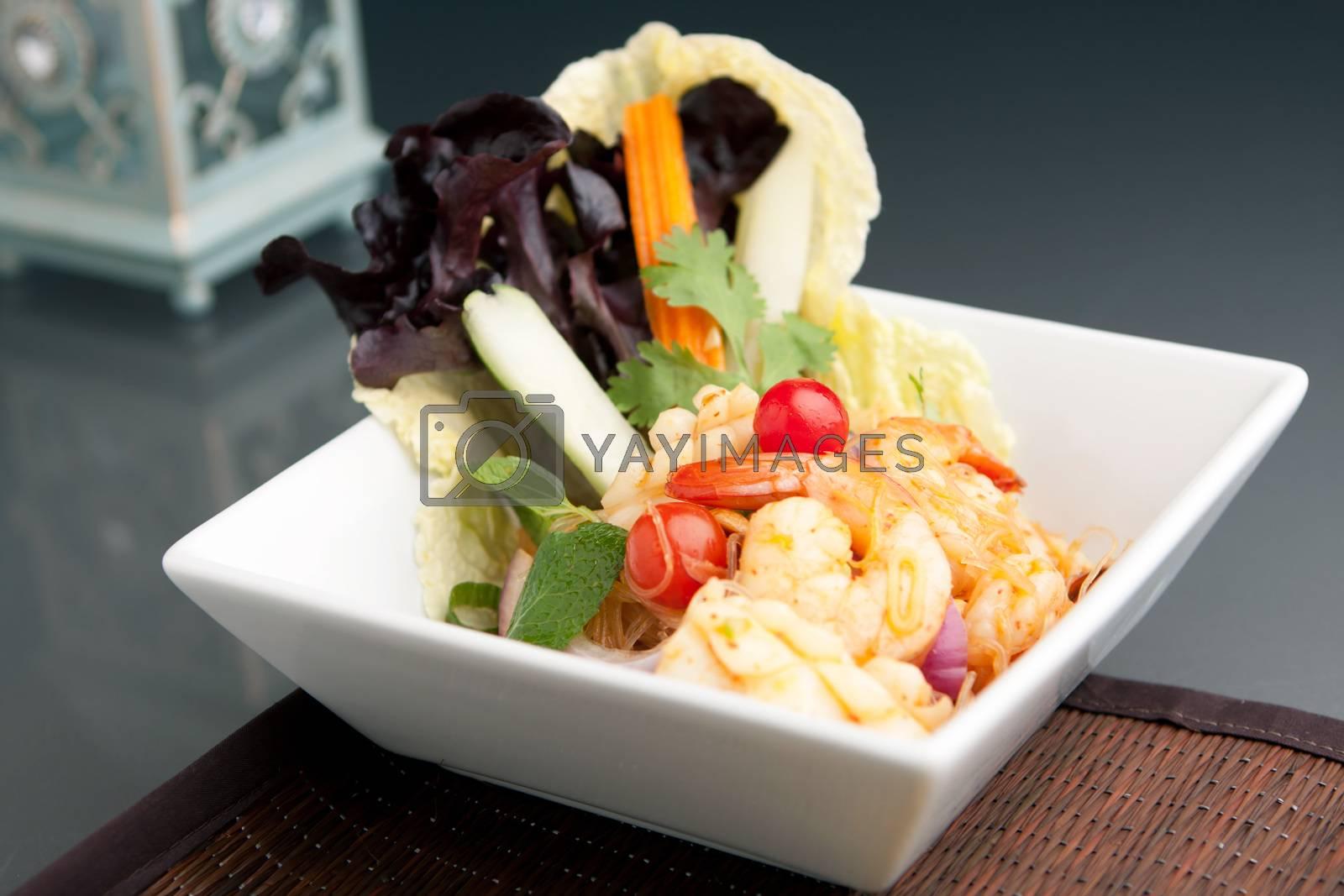 Thailand style shrimp and squid salad with veggies.
