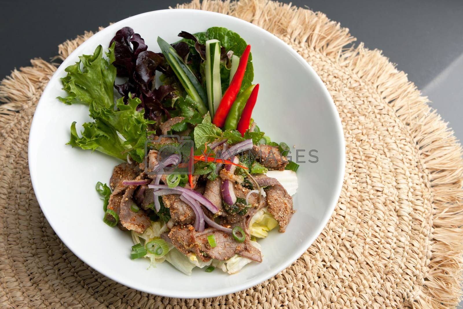 Asian style Thai salad with steak and fresh vegetables.