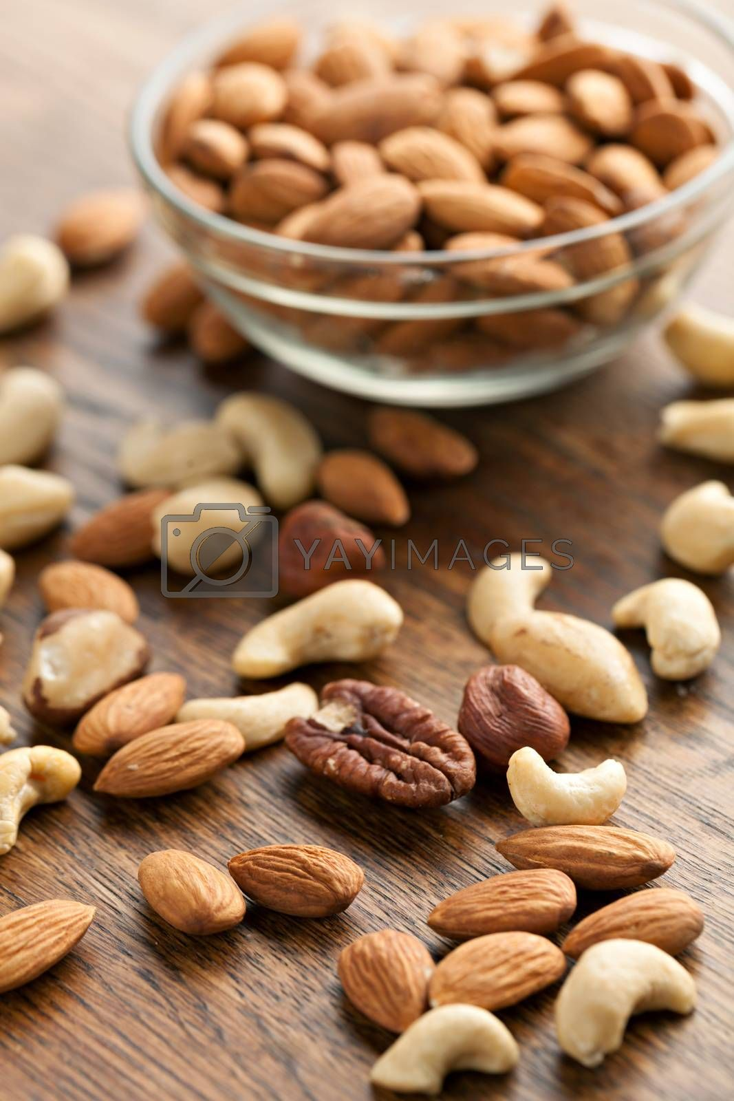 Organic mixed nuts in raw form unroasted and unsalted.  Close up macro still life with a shallow depth of field.