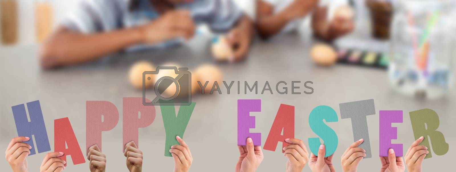 Royalty free image of Composite image of hands holding up happy easter by Wavebreakmedia