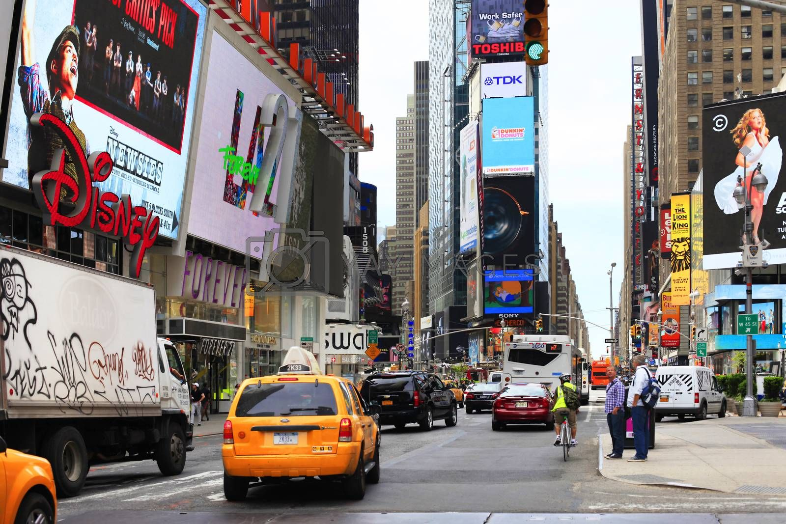 New York, NY, USA - May 17, 2013: Times Square, featured with Broadway Theaters and huge number of LED signs, is a symbol of New York City and the United States, May 17, 2013 in Manhattan, New York City