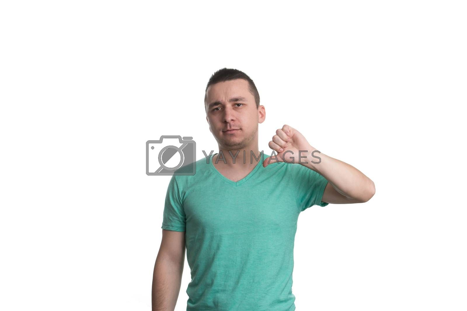 Young Man Lowered His Fist With The Thumb Down - Disgruntled Gesture - Isolated On White Background