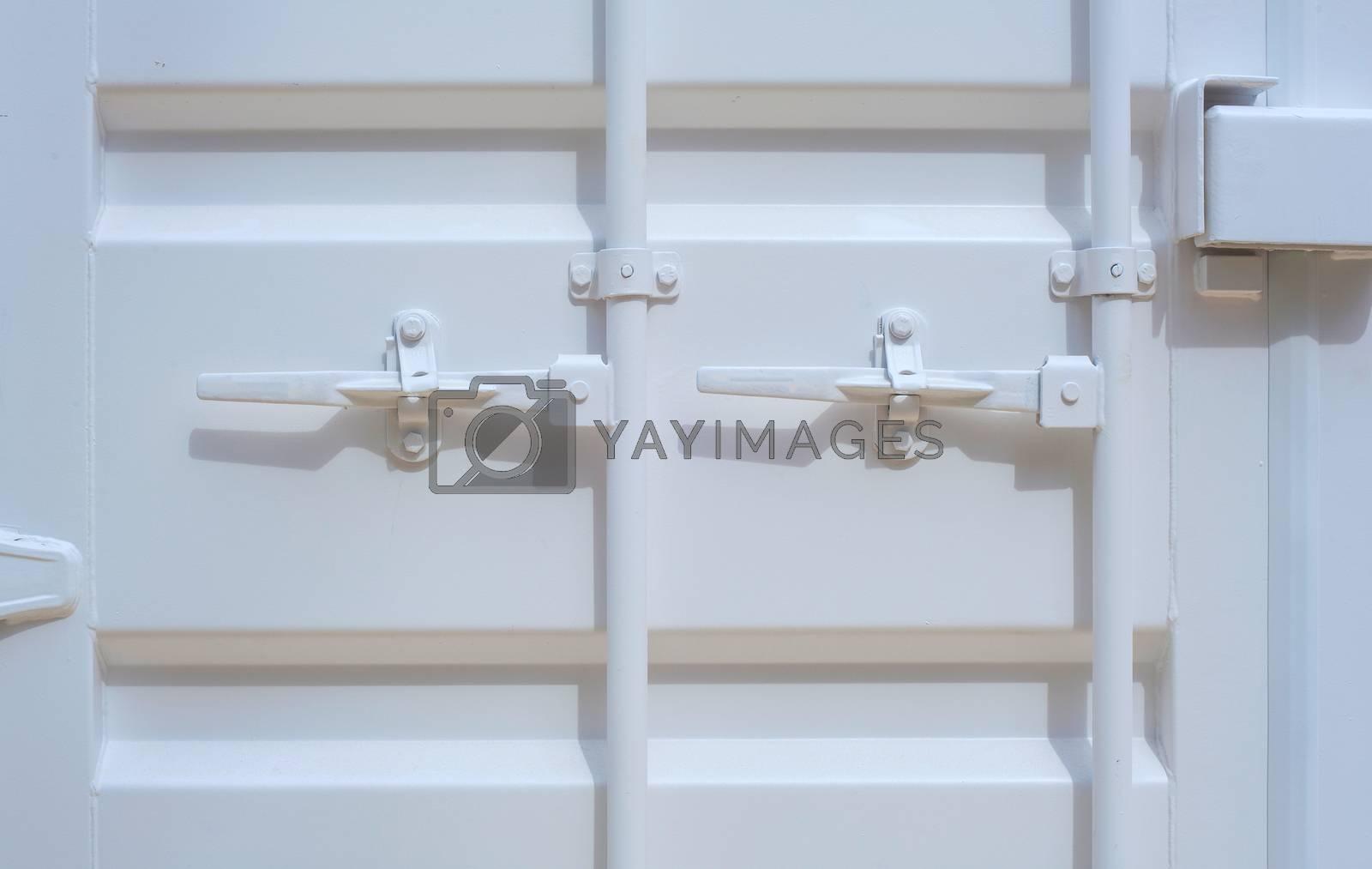View of iron white door with iron handle