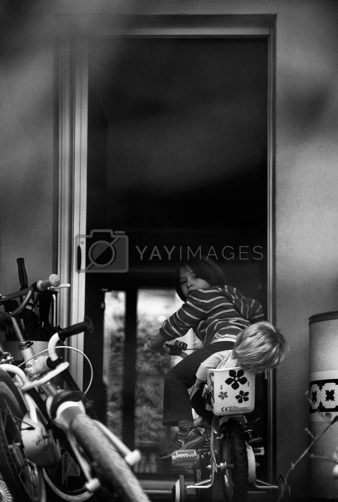 Child on the bike by bepsimage
