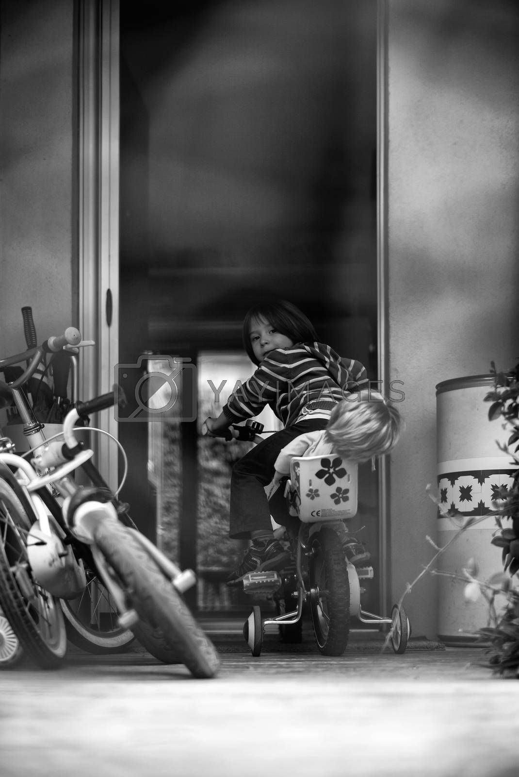 View of Child playing with the bike