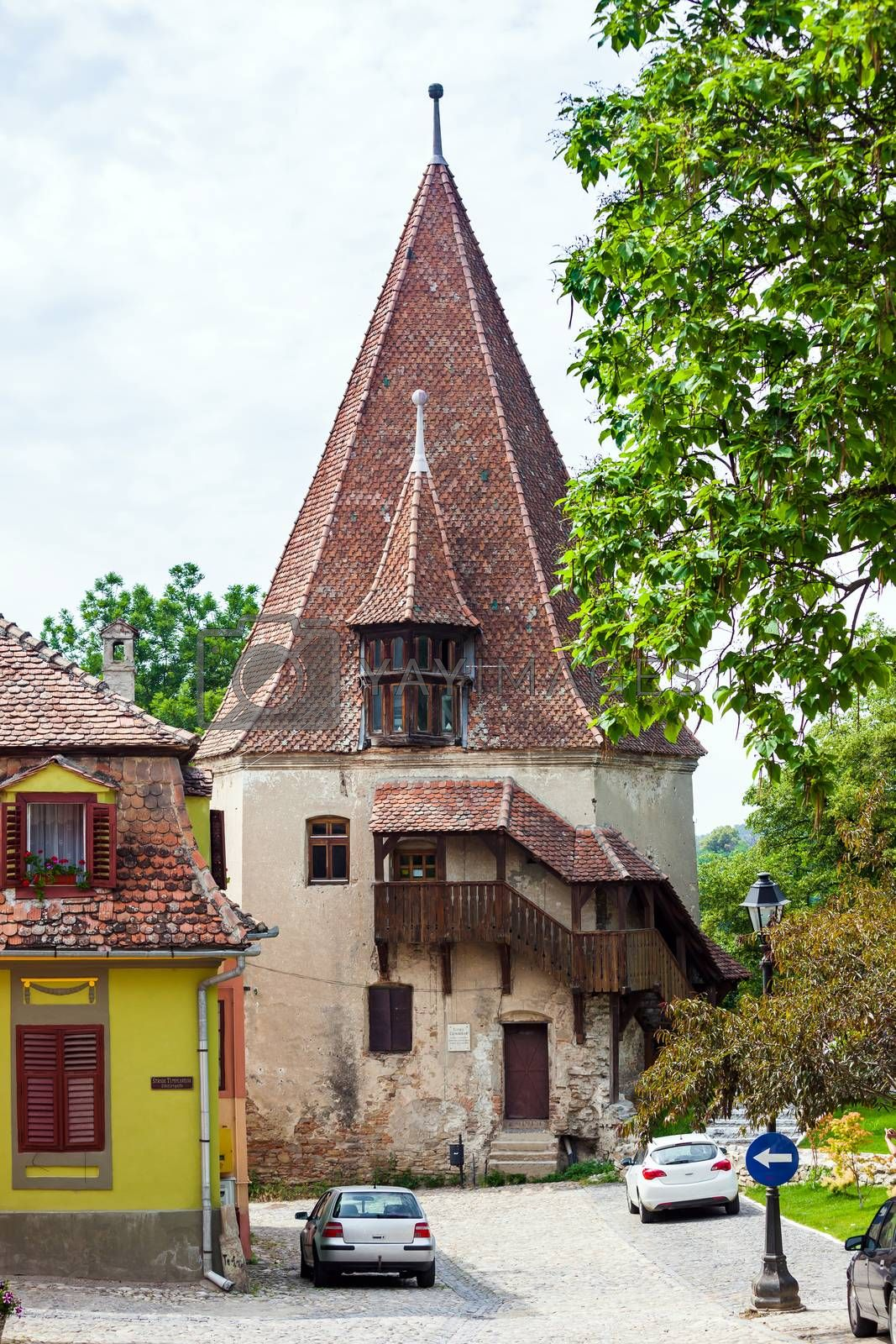 Sighisoara, Romania - June 23, 2013: Shoemakers tower (Turnul Cizmarilor) part of  Sighisoara fortress in Transylvania, Romania